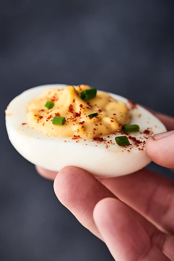 These Easy Deviled Eggs are a cinch to make thanks to my trick for making the best hard boiled eggs! They're also delicious and loaded with the creamiest filling of mayo, apple cider vinegar, dijon, horseradish, Worcestershire, relish, salt, paprika, and chives! showmetheyummy.com #deviledeggs #eggs