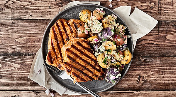 #ad Grilled Potato Salad with Hickory Smoked Brown Sugar Pork Chops aka the perfect summer dinner! Juicy fresh pork paired with a grilled potato salad that's loaded with blue cheese, bacon, garlic, red onion, cilantro, and more! Quick. Easy. Delicious! showmetheyummy.com Made in partnership w/ @smithfieldfoods #RealFlavorRealFast #SmithfieldGetGrilling #summer #grilling #potatosalad