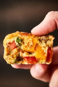 These Roasted Vegetable Breakfast Muffins make the perfect easy, healthy, make ahead breakfast! Whole eggs, egg whites, veggies: sweet potatoes, asparagus, bell pepper, onion -  and spices get baked into portable egg muffin cups! Gluten Free. Vegetarian! Less than 100 calories per muffin! showmetheyummy.com #healthy #eggmuffincups #roastedvegetables