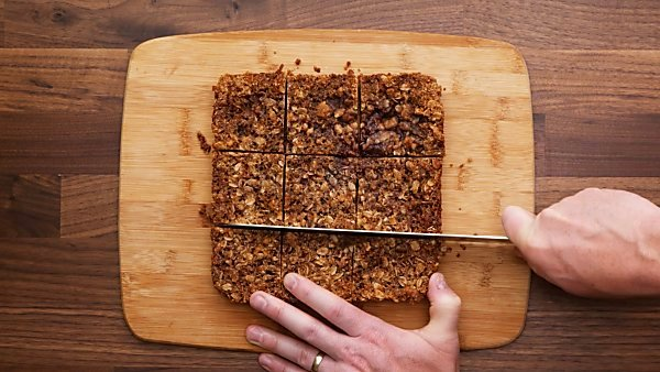 finished vegan raspberry bars being sliced