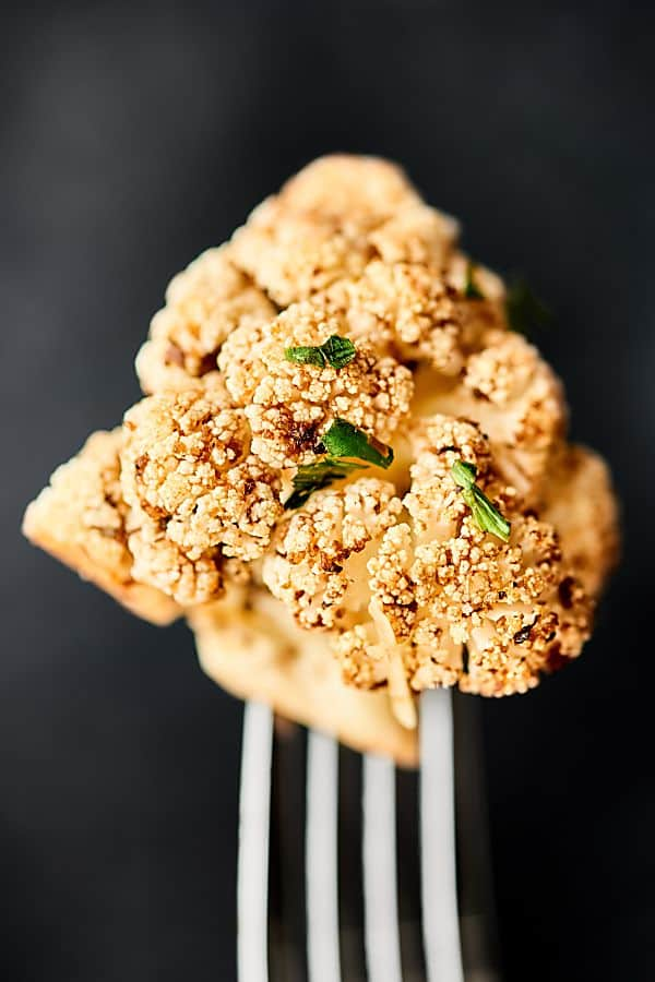 This Mediterranean Roasted Cauliflower Recipe is healthy, gluten free, can be vegan, and is absolutely delicious! Marinated in lemon juice, balsamic vinegar, and spices: salt, basil, garlic powder, onion powder, pepper, oregano, and thyme all day and roasted to perfection. Quick and easy vegetable side dish! showmetheyummy.com #mediterranean #roastedcauliflower