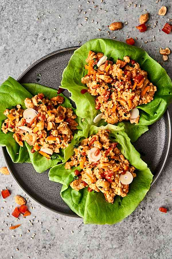These Thai Peanut Chicken Lettuce Wraps are quick, easy, and healthy! Full of veggies: onion, carrot, and red pepper, ground chicken or turkey, and the most delicious homemade easy peanut sauce! showmetheyummy.com #peanutsauce #lettucewraps #thai #healthyrecipe