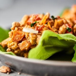 These Thai Peanut Chicken Lettuce Wraps are quick, easy, and healthy! Full of veggies: onion, carrot, and red pepper, ground chicken or turkey, and the most delicious homemade easy peanut sauce! showmetheyummy.com #peanutsauce #lettucewraps #thai