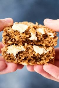 These Easy Coconut Oatmeal Cookies are gluten free and full of old fashioned oats, white chocolate, and sweetened coconut! Quick, easy, thick, chewy, and soooo warm and cozy! showmetheyummy.com #glutenfree #cookies #oatmealcookies #coconutoatmealcookies #whitechocolate