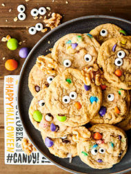 {New!} #ad These festiveHalloween Monster Eye Walnut Cookies are SO cute and perfect for Halloween! A quick and easy cookie loaded with maple syrup, walnuts, mini m&ms, and candy eyeballs! showmetheyummy.com Made in partnership w/ @CAWalnuts #halloween #cookies #monster