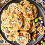 {New!} #ad These festive Halloween Monster Eye Walnut Cookies are SO cute and perfect for Halloween! A quick and easy cookie loaded with maple syrup, walnuts, mini m&ms, and candy eyeballs! showmetheyummy.com Made in partnership w/ @CAWalnuts #halloween #cookies #monster