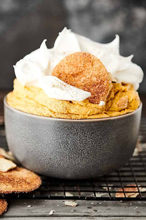 bowl of pumpkin pie dip with whipped cream