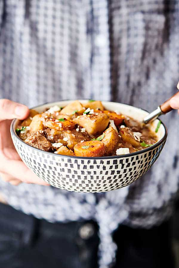 This Slow Cooker Beef Stew is SO easy to make. It's the perfect cozy, hearty fall meal! Loaded with chuck roast, veggies: onion, potatoes, carrots, and celery - beef broth, red wine (optional), and spices! A stick-to-your-ribs meal made healthier! showmetheyummy.com #slowcooker #crockpot #beefstew