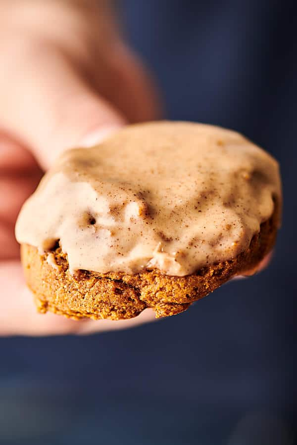 pumpkin cookie with maple glaze held