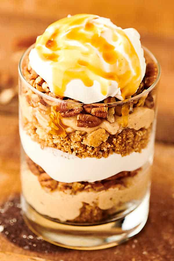 Caramel Apple Cheesecake Parfaits. Graham cracker crumbles, easy no-bake caramel cheesecake filling, pecans, cool whip, and apple pie filling . . . This cozy fall dessert is easy AND delicious! Cool whip and canned apple pie filling alternatives included! showmetheyummy.com #cheesecake #caramel #apple #applepie