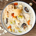This Crockpot Creamy Chicken Noodle Soup Recipe is packed withhealthy foods like lean chicken, veggies: onion, garlic, carrots, celery, mushrooms - and spices. It's also SO creamy and satisfying thanks to a bit of half & half, a touch of cream cheese, and rotini pasta noodles. Hearty, but not heavy at all! The perfect cozy winter soup.showmetheyummy.com #crockpot #chickennoodlesoup #chicken #soup #pasta