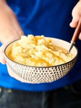 Instant Pot Mashed Potatoes. Yukon gold potatoes cooked in broth, then drained and mixed with buttermilk, butter, cream cheese, sour cream, parmesan cheese, and spices: salt, pepper, and garlic powder. Only 12 minutes required! Quick. Easy. Fluffy. Delicious! showmetheyummy.com #instantpot #mashedpotatoes