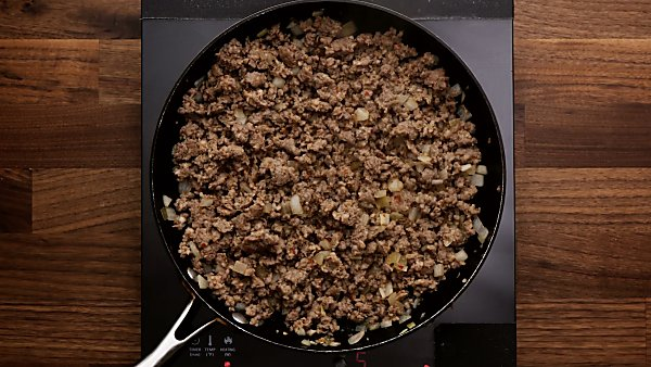 sausage and onion cooked in skillet