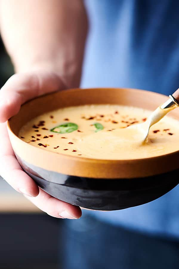 This Easy Beer Cheese Soup Recipe is SO rich and creamy and is loaded with bacon, celery, carrots, onion, garlic, beer, a touch of worcestershire, dijon mustard, and three kinds of cheese: pepperjack (or something else if you don't like the spice), cheddar, and cream cheese! showmetheyummy.com #beer #cheese #soup