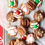 Easy Pretzel Turtles Recipe - 4 Ways. 1. Pretzels with rolos and pecans. 2. Pretzels with peppermint kisses and m&ms. 3. Pretzels with Hershey's hugs and m&ms. 4. Pretzels with peanut butter cups and honey roasted peanuts. All 3 ingredients, quick, easy, and of course, delicious! showmetheyummy.com #pretzel #turtles #pretzelturtles #candy #caramel #chocolate #peppermint #peanutbutter #whitechocolate #christmascandy