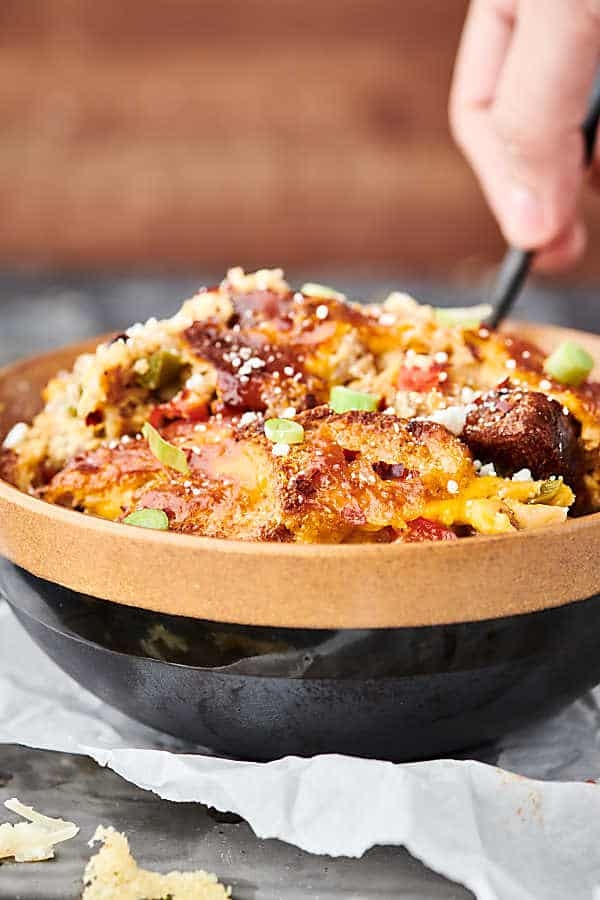 This Overnight Breakfast Sausage Casserole can be prepped and made the night before! Store it in your fridge overnight and bake the next morning. Quick, easy, and loaded with sausage, peppers, onions, toasted bread, eggs, milk, and of course, cheese! showmetheyummy.com #overnightbreakfastcasserole #breakfast #casserole #sausage #eggs #cheese #bread