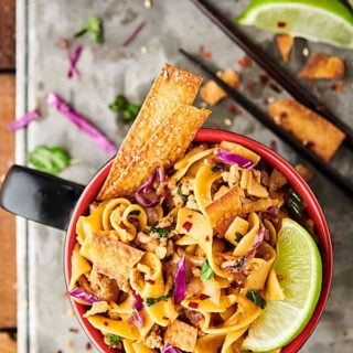 {New!} #ad Egg Roll Noodle Bowl Recipe. Pasta mixed with a flavorful egg roll filling made of pork, onion, spices, coleslaw, soy sauce, seasoned rice vinegar, sesame oil, sriracha, green onions, cilantro, and crispy wonton or egg roll wrapper strips! showmetheyummy.com Made in partnership w/ @noyolksnoodles #DoItWithNoYolks #eggroll #pasta