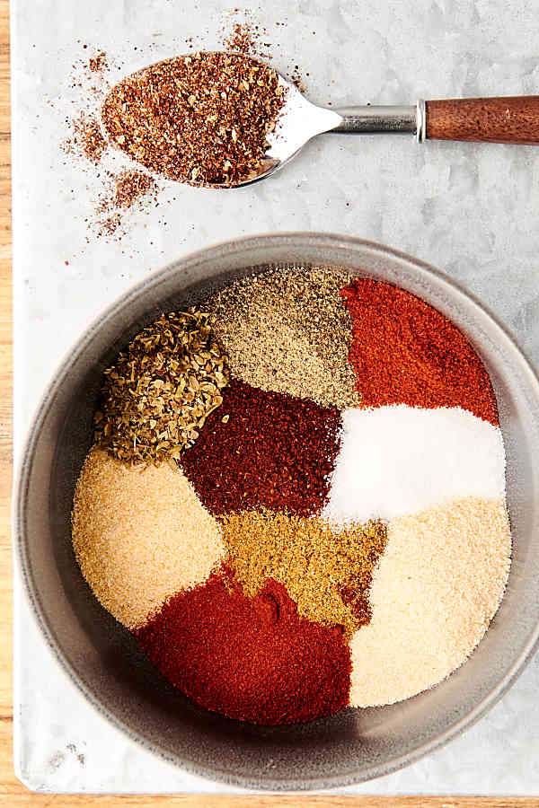 taco seasoning ingredients unmixed in bowl above