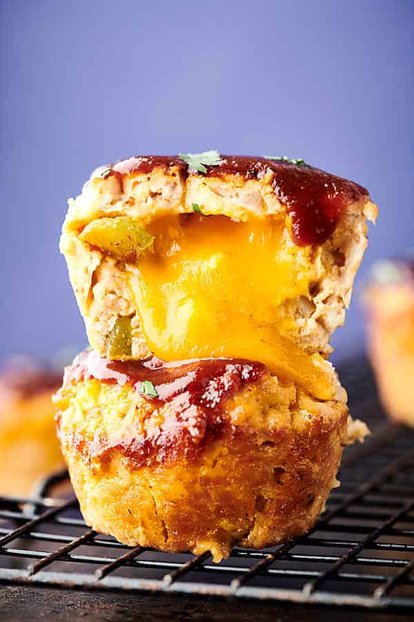 Healthy BBQ Cheddar Turkey Meatloaf Muffin Cups Recipe. These muffin tin meatloaves are loaded with oatmeal (trust me) instead of bread for a healthier twist, buttermilk, turkey, onion, peppers, spices, BBQ sauce, and a touch of cheddar cheese! Only 177 calories per cup!  showmetheyummy.com #bbq #cheddar #turkey #meatloaf #healthy #glutenfree