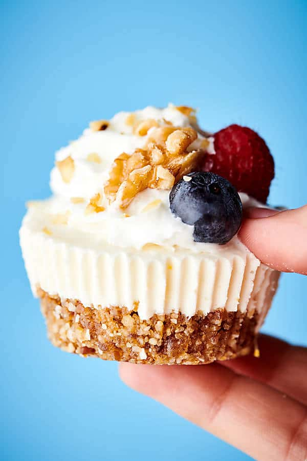 {New!} #ad Healthier Lemon Walnut No Bake Cheesecakes. A naturally sweetened walnut date crust topped with a creamy coconut yogurt, cream cheese, honey, lemon filling! I love this quick and easy recipe with short ingredient list! showmetheyummy.com Made in partnership w/ @cawalnuts #healthy #lemon #walnut #nobake #cheesecake #coconut #glutenfree #vegetarian #dessert #spring
