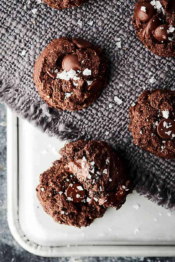Healthy Double Chocolate Almond Butter Cookies Recipe. Flourless, gluten free, can be vegan! Made with flaxseed meal, cocoa powder, honey (or vegan alternative like maple syrup or agave), almond butter, vanilla, baking soda, salt, and dark chocolate chips! Less than 150 calories per cookie! showmetheyummy.com #healthy #almondbutter #chocolate #cookies #glutenfree #vegan #dessert