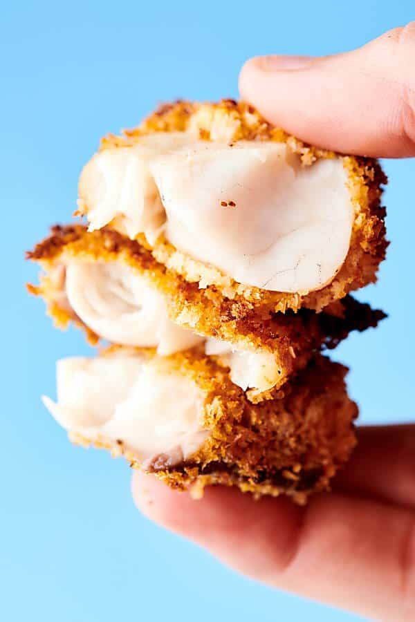 This Homemade Healthy Air Fryer Fish Sticks Recipe only requires 10 ingredients (INCLUDING salt and pepper): cod or tilapia, spices: salt, pepper, paprika, garlic powder, whole wheat flour, eggs, lemon juice, panko breadcrumbs, and old bay seasoning! Oven baked instructions listed as well. showmetheyummy.com #healthy #fishsticks #airfryer #baked