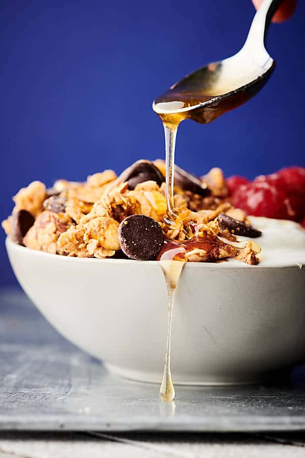 Almond Butter Granola. A healthy, can be gluten free and vegan recipe made with crunchy almond butter, coconut oil, honey (or agave), maple syrup, oats, almonds, dark chocolate chips, and more! Quick. Easy. Delicious! showmetheyummy.com #almondbutter #granola #healthy #glutenfree #vegan #snack #chocolate