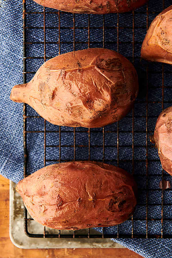 """""""baked"""" sweet potatoes on cooling rack"""