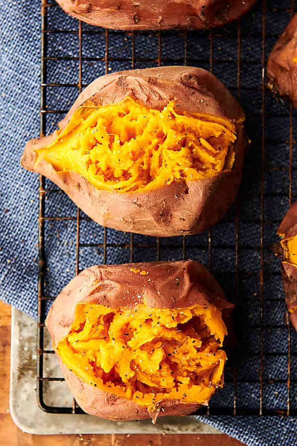 "Instant Pot Sweet Potatoes. ""Baked"" sweet potatoes made quicker in the instant pot! Vegan, gluten free, and SO versatile! showmetheyummy.com #instantpot #sweetpotatoes #vegan #glutenfree"