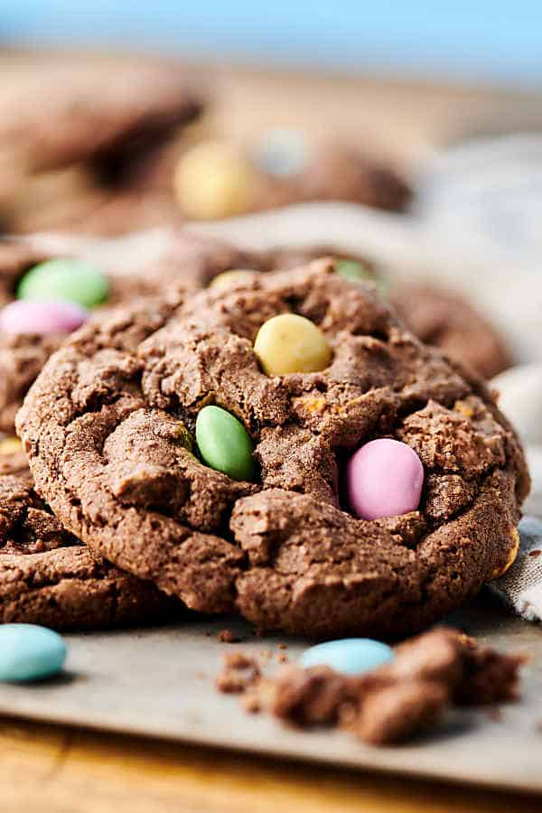 Double Chocolate Cadbury Egg Cookies. A chewy double chocolate cookie loaded with Cadbury Mini Eggs and Easter M&Ms! A quick and easy festive treat for Easter or spring! showmetheyummy.com #chocolate #easter #cookies #cadbury #m&ms