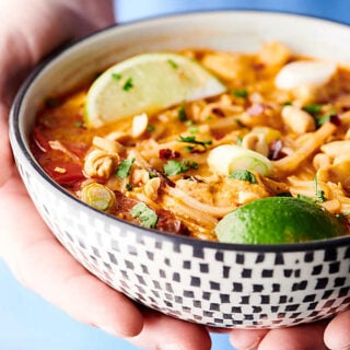 Coconut Curry Chicken Noodle Soup Recipe. Quick, easy, healthy, gluten free, and dairy free! Loaded with veggies, spices, peanut butter, red curry paste, a touch of brown sugar, broth, lite coconut milk, fish sauce, chicken, lime juice, rice noodles, fresh herbs, and peanuts! showmetheyummy.com #coconut #curry #chicken #noodle #soup #thai #healthy #recipe