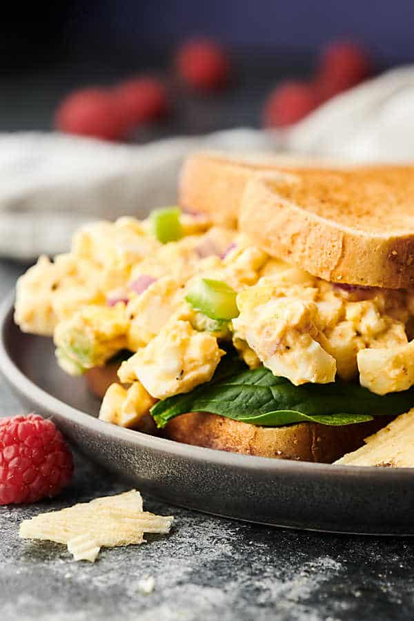 egg salad sandwich on plate side view