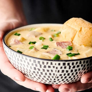 Ham and Cheese Potato Soup. A quick and easy classic loaded with veggies, chicken broth, half and half, potatoes, leftover ham, sour cream, cheddar cheese, and swiss cheese! Hearty, yet light! A family favorite.showmetheyummy.com #ham #cheese #potato #soup