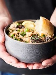 Instant Pot Mushroom Risotto. A classic made in the pressure cooker and loaded with butter, onions, spices, baby belly mushrooms, garlic, Arborio rice, a splash of wine, vegetable broth, baby spinach, peas, three kinds of cheese: asiago, romano, and parmesan, and fresh lemon juice/zest! A decadent vegetarian main or a creamy side dish to your favorite protein! showmetheyummy.com #instantpot #mushroom #risotto #glutenfree #vegetarian