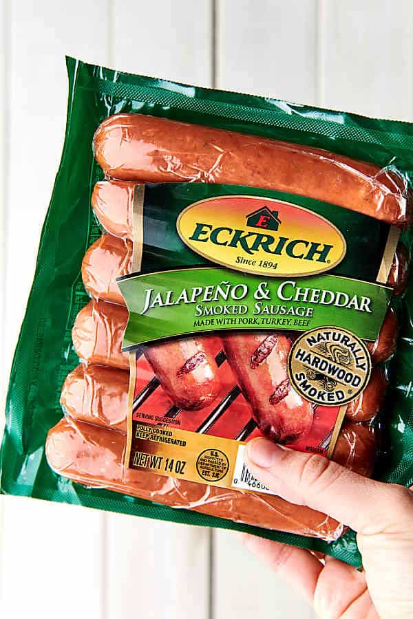 package of jalapeno cheddar smoked sausage held