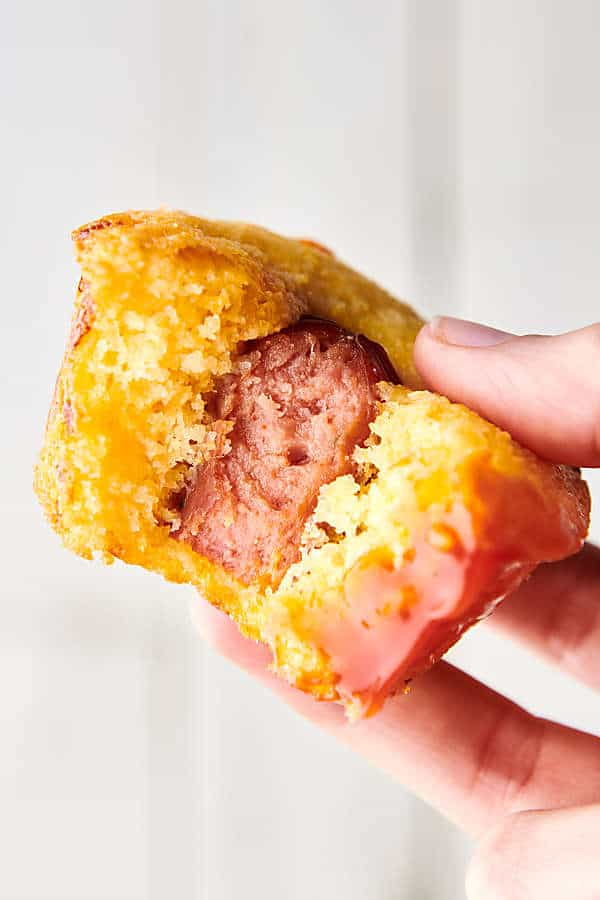 jalapeno cheddar smoked sausage corn muffin with bite out held