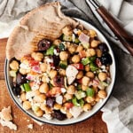 Mediterranean Chickpea Egg Salad Recipe. A chopped salad loaded with chickpeas, hard boiled eggs, red peppers, green peppers, cucumber, onion, kalamata olives, red wine vinegar, garlic powder, oregano, basil, dill, and salt! Vegetarian. Dairy Free. Gluten Free. Meal prep friendly! Healthy lunch! showmetheyummy.com #mediterranean #chickpea #egg #salad #healthy #glutenfree #dairyfree #vegetarian #mealprep #lunch