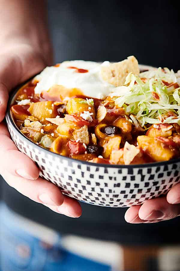 This One Pot Taco Mac and Cheese is loaded with ground beef, onions, bell peppers, garlic, taco seasoning, pasta shells, milk, broth, black beans, and THREE kinds of cheese: sharp cheddar cheese, pepper jack cheese, and monterey jack cheese. Don't forget about the fun toppings like tortilla chips, sour cream, shredded lettuce, taco sauce, and more! Kid and adult approved! showmetheyummy.com #onepot #taco #mac #cheese #macandcheese