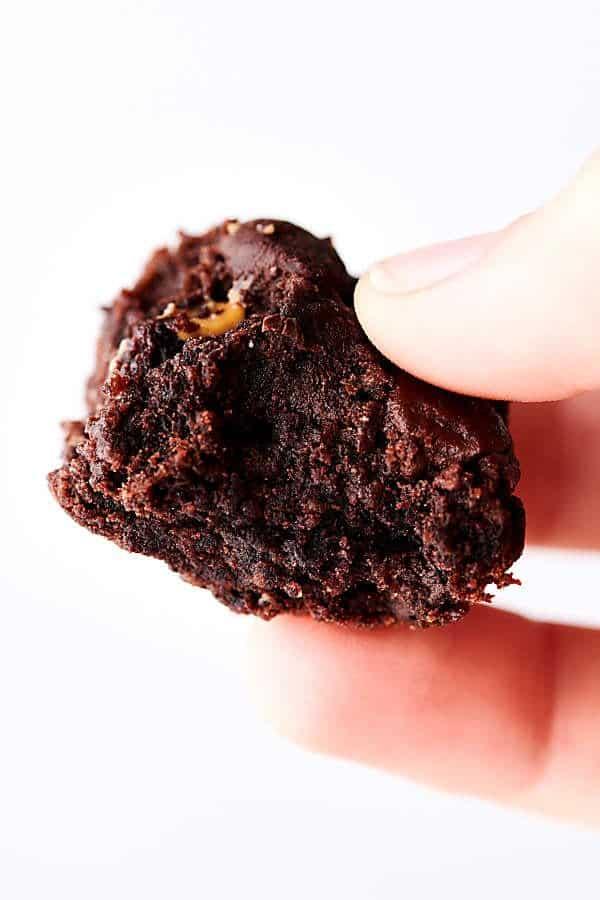 Piece of black bean brownie held
