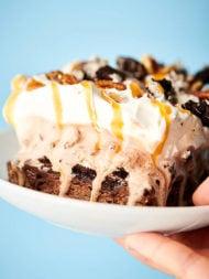 Holding caramel fudge brownie ice cream cake