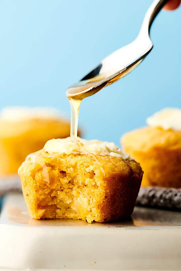 These Easy Cornbread Muffins are quick, easy, and naturally gluten free! They're ultra fluffy, tender, and loaded with flavor thanks to butter, honey, eggs, sour cream, cornmeal, baking soda, salt, cream style corn, and sweet corn! showmetheyummy.com #cornbread #muffins #glutenfree #honey