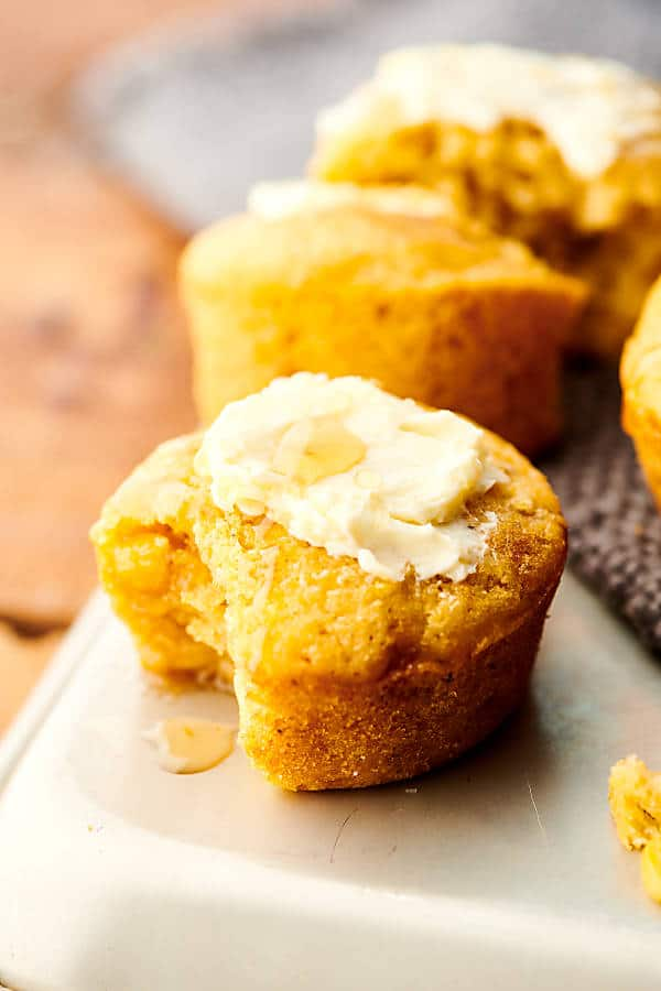 cornbread muffin on tray with others in background
