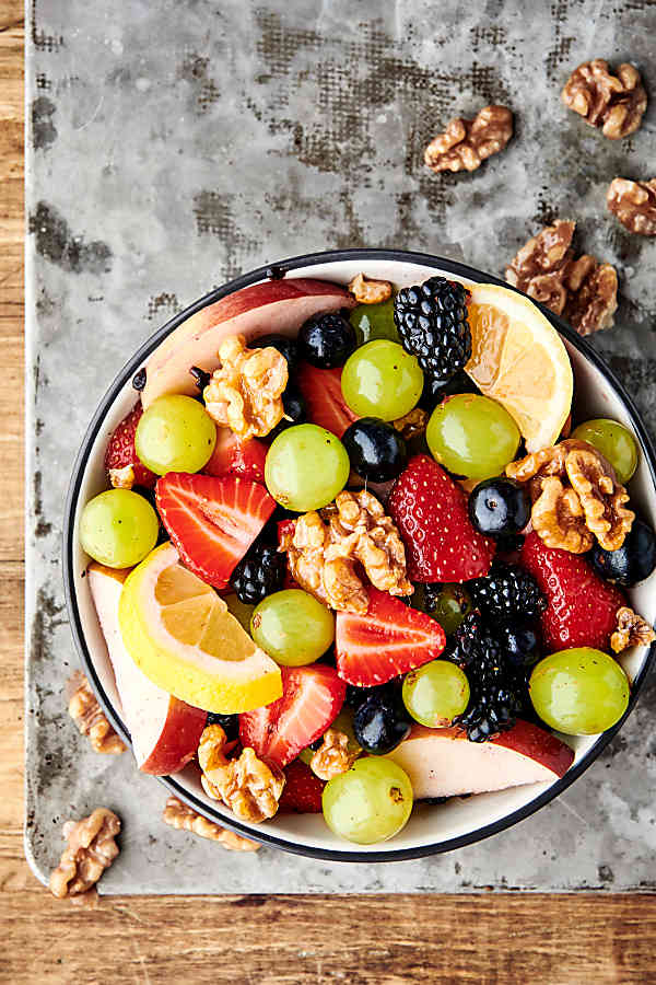 fruit salad with honey walnuts overhead