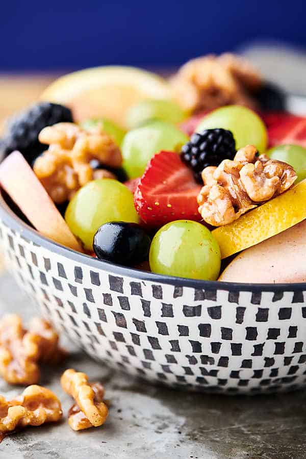 fruit salad with honey walnuts close up