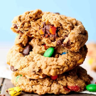 The Best Monster Cookie Recipe. Naturally gluten free cookies loaded with butter, brown sugar, granulated sugar, vanilla, creamy peanut butter, oats, M&Ms, and chocolate chips. They really are the best monster cookies ever! showmetheyummy.com #monstercookies #monster #cookie #glutenfree #peanutbutter #oats #chocolate