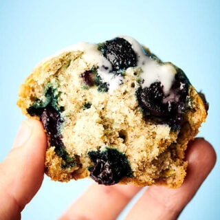 vegan blueberry muffins holding in hand