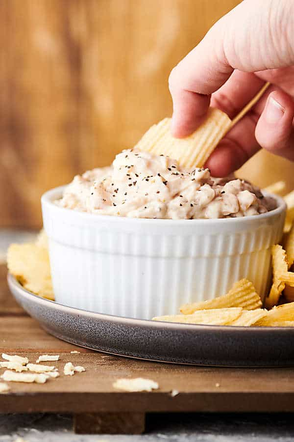 dipping chip into french onion dip