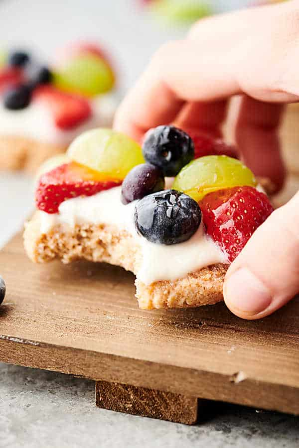 healthy fruit pizza cookies in hand
