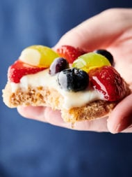 healthy fruit pizza cookies blue background