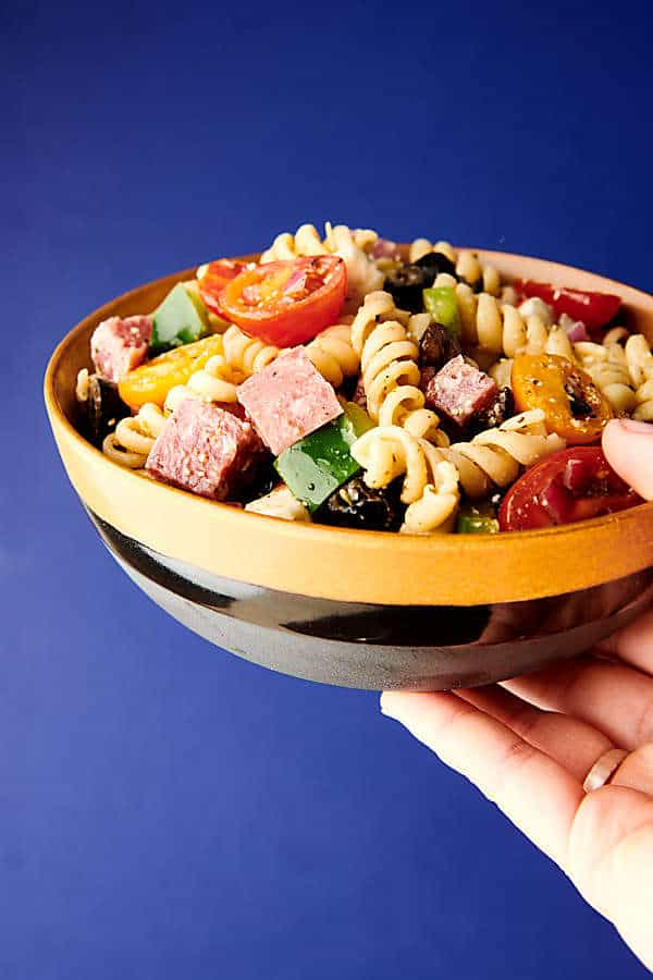 Italian pasta salad blue background